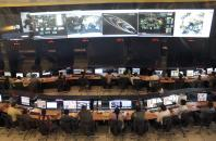 Indian Space Research Organization (ISRO) scientists and engineers monitor the movements of India's Mars orbiter at their Spacecraft Control Center in the southern Indian city of Bangalore November 27, 2013.