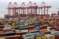 Containers are seen at the Yangshan Deep Water Port in Shanghai, China April 24, 2018. REUTERS/Aly Song/File Photo