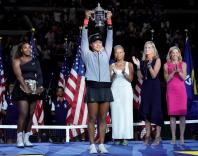 Naomi Osaka of Japan holds the U.S. Open trophy after beating Serena Williams of the USA in the women's final on day thirteen of the 2018 U.S. Open tennis tournament at USTA Billie Jean King National Tennis Center. Mandatory Credit: Robert Deutsch-USA TOD