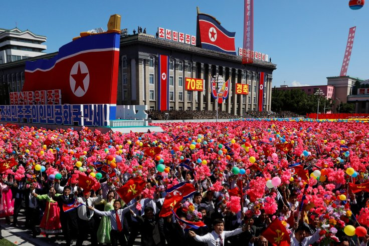 People wave plastic flowers and balloons during a military parade marking the 70th anniversary of North Korea's foundation in Pyongyang, North Korea, September 9, 2018. REUTERS/Danish Siddiqui