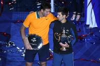 (L-R) Juan Martin Del Potro of Argentina and Novak Djokovic of Serbia poses with the runner-up and championship trophies (respectively) on day fourteen of the 2018 U.S. Open tennis tournament at USTA Billie Jean King National Tennis Center. Mandatory Cred