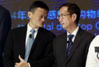 Alibaba Founder and Chairman Jack Ma (L) talks to CEO Daniel Zhang at NYSE Bell Ringing ceremony during Alibaba Group's 11.11 Global shopping festival in Beijing, China, November 11, 2015. REUTERS/Kim Kyung-Hoon/File Photo