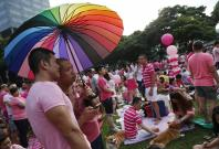 Participants dressed in pink enjoy a picnic before taking part in the forming of a giant pink dot at the Speakers' Corner in Hong Lim Park in Singapore June 28, 2014. The annual Pink Dot Sg event promotes an acceptance of the Lesbian, Gay, Bisexual and Tr