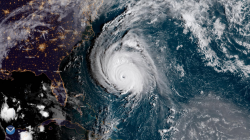An outsized Hurricane Florence early on Thursday crept closer to the U.S. East Coast, packing tropical storm-force winds across hundreds of miles that threaten the region with potentially catastrophic flooding and torrential rain.