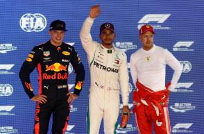 Formula One F1 - Singapore Grand Prix - Marina Bay Street Circuit, Singapore - September 15, 2018 Mercedes' Lewis Hamilton poses for a photograph on the podium after qualifying in pole position alongside second place Red Bull's Max Verstappen and third pl