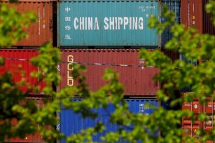 """Shipping containers, including one labelled """"China Shipping,"""" are stacked at the Paul W. Conley Container Terminal in Boston, Massachusetts, U.S., May 9, 2018. REUTERS/Brian Snyder/File Photo"""
