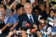 Malaysia's former Prime Minister Najib Razak speaks to journalists as he leaves a court in Kuala Lumpur, Malaysia September 20, 2018. REUTERS/Lai Seng Sin