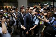Andy Chan, a founder of the Hong Kong National Party, is surrounded by photographers as he leaves the Foreign Correspondents' Club in Hong Kong, China August 14, 2018. REUTERS/Bobby Yip
