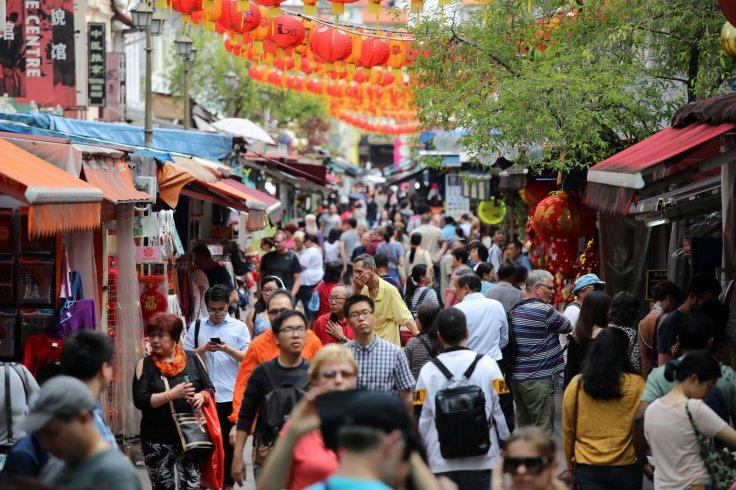 People walk through Chinatown in Singapore