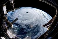 Super Typhoon Trami is seen from the International Space Station as it moves in the direction of Japan, September 25, 2018 in this image obtained from social media on September 26, 2018.