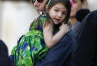 U.S. actor Tom Cruise holds his daughter Suri