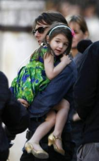 U.S. actor Tom Cruise holds his daughter Suri