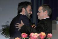 Director Ben Affleck (L) receives the Modern Master Award from actor Matt Damon at the 28th Santa Barbara International Film Festival in Santa Barbara, California