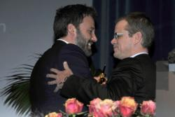 Director Ben Affleck (L) receives the Modern Master Award from actor Matt Damon at the 28th Santa Barbara International Film Festival in Santa Barbara, California