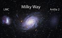 Astronomers sifting through data from the Gaia spacecraft have found a previously unseen dwarf galaxy lurking near the Milky Way. In this artist's impression, the Large Magellanic cloud can be seen to the left of the Milky Way, center, while the newly dis