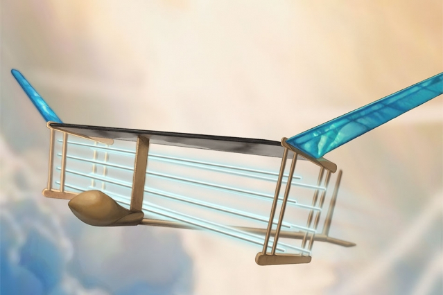 A new MIT plane is propelled via ionic wind. Batteries in the fuselage (tan compartment in front of plane) supply voltage to electrodes (blue/white horizontal lines) strung along the length of the plane, generating a wind of ions that propels the plane fo