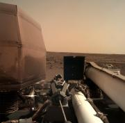 The Instrument Deployment Camera (IDC), located on the robotic arm of NASA's InSight lander, took this picture of the Martian surface on Nov. 26, 2018, the same day the spacecraft touched down on the Red Planet. The camera's transparent dust cover is stil