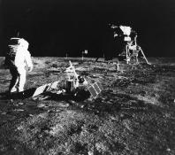 "The Chinese National Space Administration has released the images kf the ""dark"" side of the moon taken by Chang'e-4. Pictured: Apollo 11 astronaut Edwin 'Buzz' Aldrin deploys a scientific experiment package on the surface of the moon. In the background is"