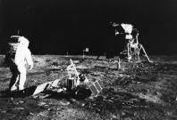"""The Chinese National Space Administration has released the images kf the """"dark"""" side of the moon taken by Chang'e-4. Pictured: Apollo 11 astronaut Edwin 'Buzz' Aldrin deploys a scientific experiment package on the surface of the moon. In the background is"""