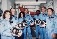 NASA lost seven of its own on the morning of Jan. 28, 1986, when a booster engine failed, causing the Shuttle Challenger to break apart just 73 seconds after launch. In this photo from Jan. 9, 1986, the Challenger crew takes a break during countdown train