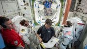 This preflight image from Feb. 6, 2019, shows NASA astronauts Mike Fincke and Nicole Mann and Boeing astronaut Chris Ferguson during spacewalk preparations and training inside the Space Station Airlock Mockup at NASA's Johnson Space Center in Houston.  Th