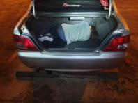 The Myanmar national hiding in the boot of a car