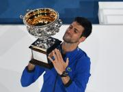 Novak Djokovic of Serbia holds up the trophy during the trophy awarding ceremony after the men's singles final match between Novak Djokovic of Serbia and Rafael Nadal of Spain at 2019 Australian Open in Melbourne, Australia, Jan. 27, 2019. (Xinhua/Bai Xu