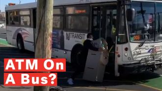 watch-comedian-tries-to-lug-a-whole-atm-machine-onto-nj-transit-bus-and-goes-viral