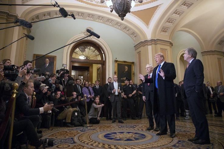 US President Donald Trump, with Senate Majority Leader Mitch McConnell to his right, speaks to reporters on Tuesday, March 26, 2019, at the US Capitol in Washington. (Photo: White House/IANS)