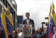 """Juan Guaido (C), head of the opposition-controlled National Assembly, delivers a speech at the Francisco de Miranda avenue, in Caracas, Venezuela, on Jan. 23, 2019. Venezuelan President Nicolas Maduro on Wednesday announced he was severing """"diplomatic and"""