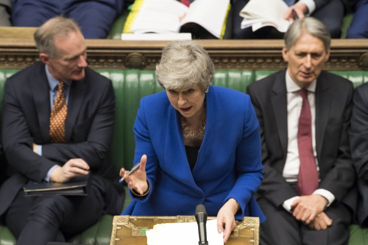 British Prime Minister Theresa May (C) attends the Prime Minister's Questions at the House of Commons in London, Britain, on April 10, 2019. Leaders of the European Union's remaining 27 member countries have agreed to an extension of Brexit, European Cou