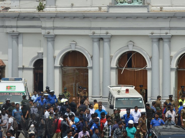People gathered outside the Church of St. Anthony where the explosion occurred in Colombo, Sri Lanka, April 21, 2019. At least 50 people were killed and more than 100 others injured in multiple church and hotel blasts in Sri Lanka, police said on Sunday.