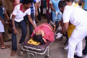 An injured woman is carried on a stretcher in a hospital in Negombo, north of Colombo, Sri Lanka, April 21, 2019. Sri Lankan Police said on Sunday that 13 people had been arrested over a series of blasts which killed 228 people across the island nation.