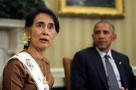 Myanmar's Suu Kyi calls for investment after Obama pledges sanctions relief