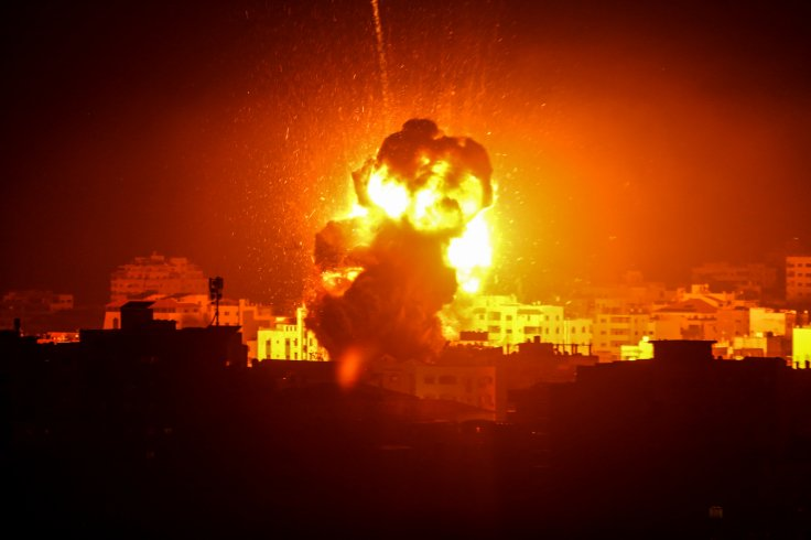 Photo taken on March 25, 2019 shows flame and smoke above buildings following an Israeli air strike in Gaza City. The Israeli army expanded air strikes on the Gaza Strip on Monday night after targeting Hamas security facilities in Gaza City, a local radio