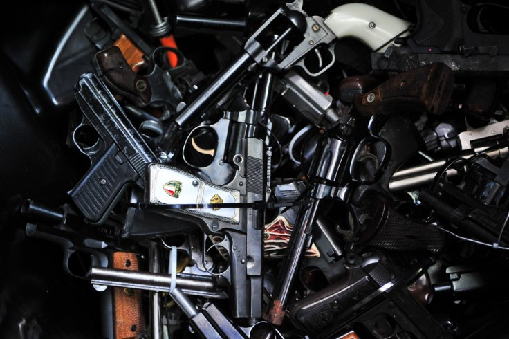 LOS ANGELES, June 1, 2014 (Xinhua) -- Surrendered handguns are displayed at a gun buyback event in Los Angeles, the United States, on May 31, 2014. People can exchange their firearms at four Los Angles-area locations for supermarket gift cards. The Citywi
