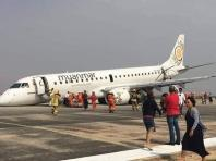 Mandalay: Myanmar Airline's Embraer E190 aircraft (ERJ-190LR) from Yangon to Mandalay which made an emergency landing after its front landing gear failed to deploy at Mandalay International Airport, on May 12, 2019. The aircraft landed with its nose wheel