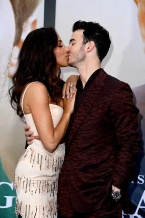Danielle Jonas and Kevin Jonas kiss at Chasing Happiness premiere.Instagram