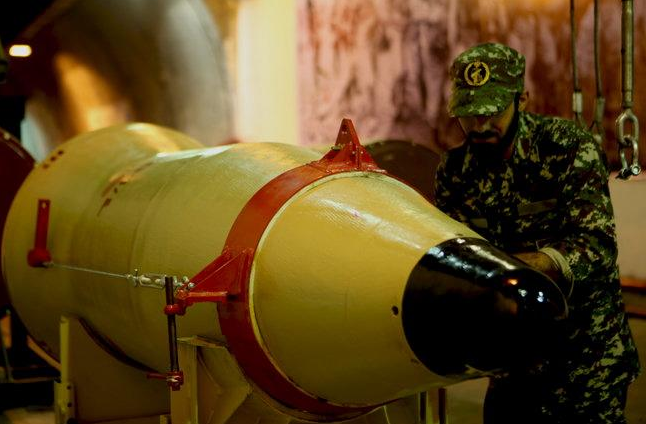 A member of the Iranian Revolutionary Guards checks a missile inside an underground depot in an undisclosed location, Iran, in this handout photo released by the official website of Islamic Revolutionary Guard Corps (IRGC) on March 8, 2016