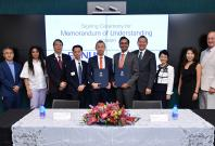 Professor Chen (fifth from left) and Mr Naveen Menon, President ASEAN, Cisco (fifth from right), signed a Memorandum of Understanding on 25 June to collaborate on innovation and research. (Photo Credit: Cisco)