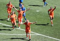 Stefanie Van Der Gragt (front) of the Netherlands celebrates scoring with her teammates during the quarterfinal between Italy and the Netherlands at the 2019 FIFA Women's World Cup in Valenciennes, France, June 29, 2019.