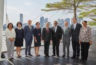 Dr Tedros Adhanom Ghebreyesus, WHO Director-General (fourth from right) and Professor Ling San, NTU Provost and Vice President (Academic) (centre), flanked by NTU professors and WHO officials.