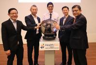 From left: Prof Lim; Prof Chen; Prof Tan;  Mr Lim Tuang Liang, Executive Director of the Research, Innovation and Enterprise Coordination Office at NRF; and Mr George Loh, Director of Services and Digital Economy at the National Research Foundation, offic