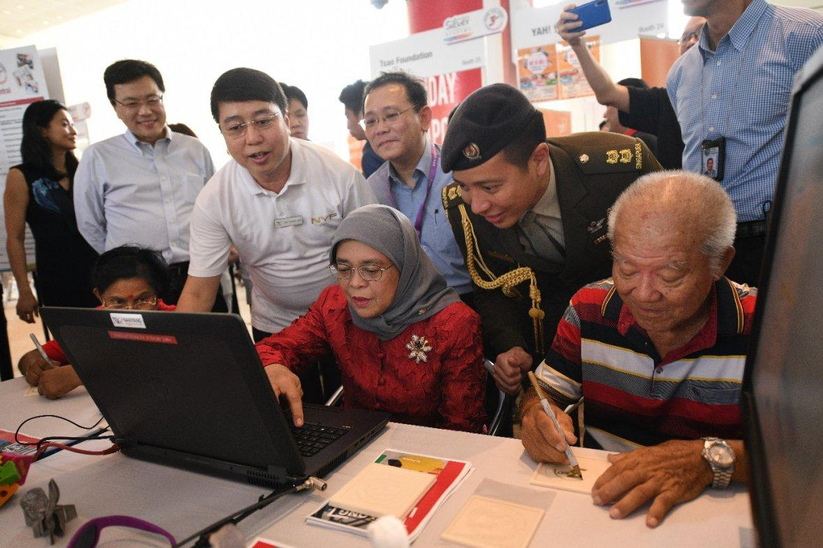 Engaging in the latest technology, President Halimah Yacob learnt how to render and 3D print at the National Silver Academy's 3rd year anniversary roadshow