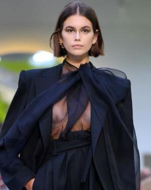 Kaia Gerber in a black sheer blouse