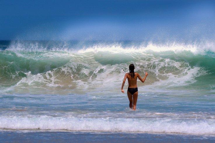 Topless Woman In Beach