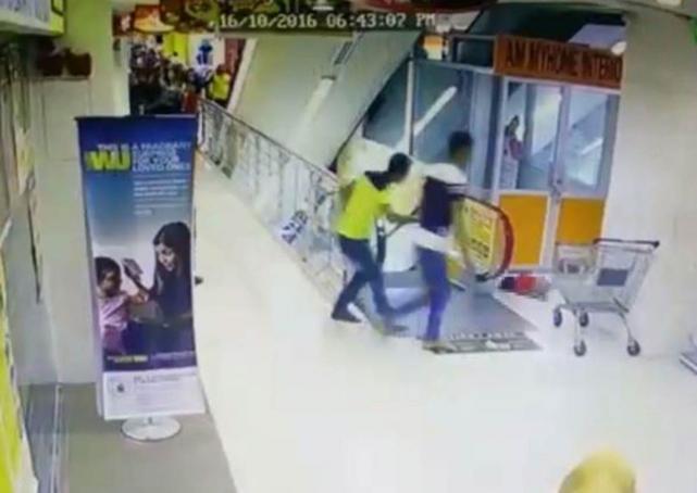 Malaysia toddler falls from escalator
