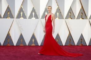 Presenter Charlize Theron arrives wearing Dior at the 88th Academy Awards in Hollywood, California February 28, 2016.
