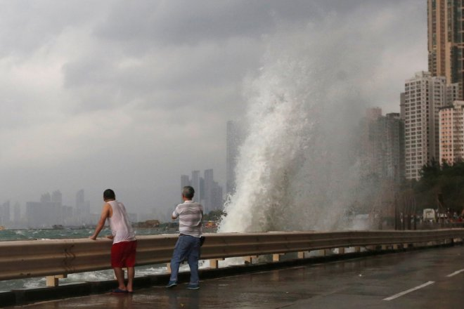 Hong Kong braces for super Typhoon Haima, shuts all but essential services