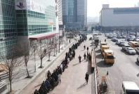 People outside a supermarket in SouthKorea